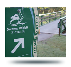 Image of Swamp Rabbit Trail sign and bridge crossing